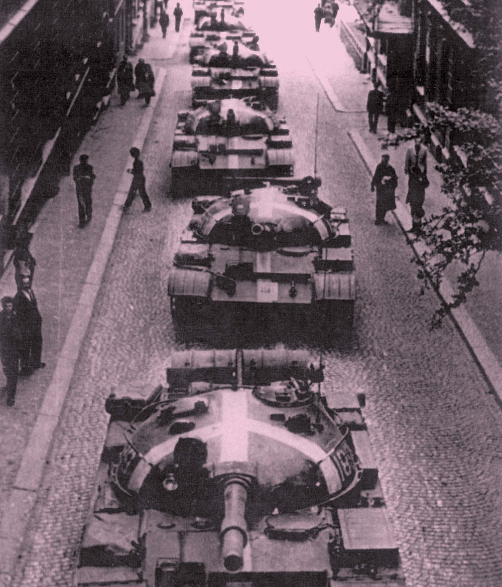 In the morning hours of August 21, 1968, Soviet and Warsaw Pact tanks roll in the streets of Prague; to distinguish them from Czechoslovak tanks, they are marked with white crosses.