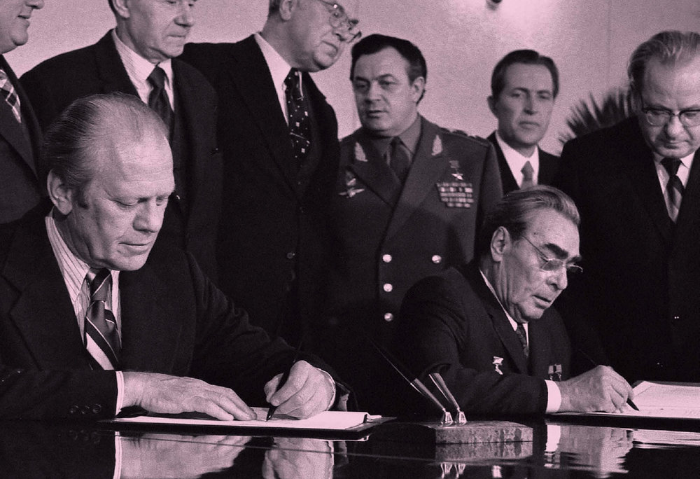 Following their bilateral talks, President Ford and Soviet General Secretary Leonid I. Brezhnev sign a joint communiqué on the limitation of strategic offensive arms in Vladivostok, USSR.  November 24, 1974.