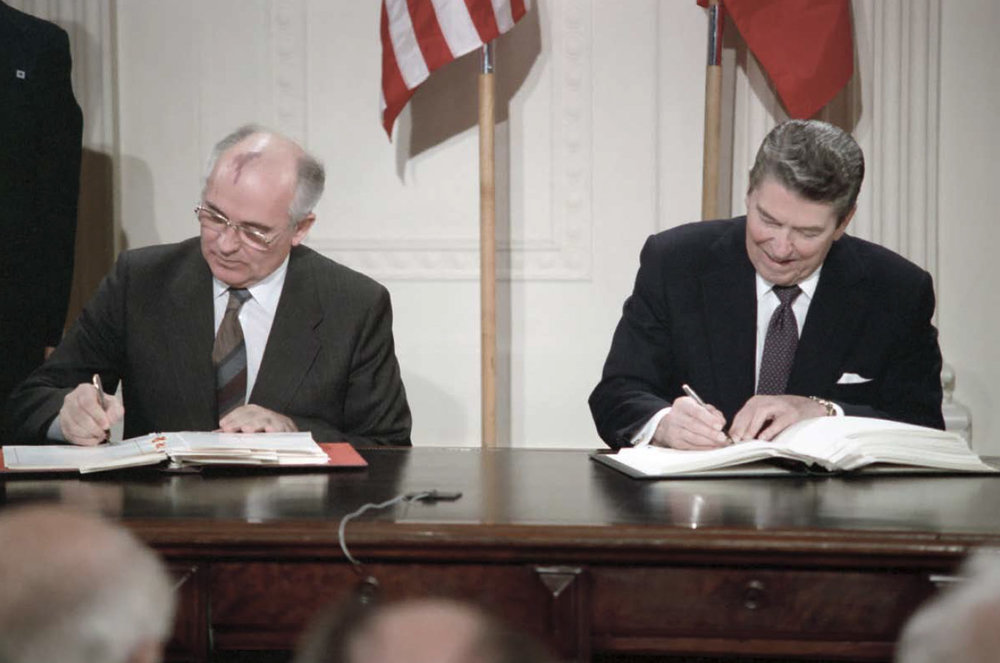During their Washington Summit meeting President Reagan and Soviet General Secretary Gorbachev are signing the INF Treaty in the East Room of the White House on August 12, 1987.