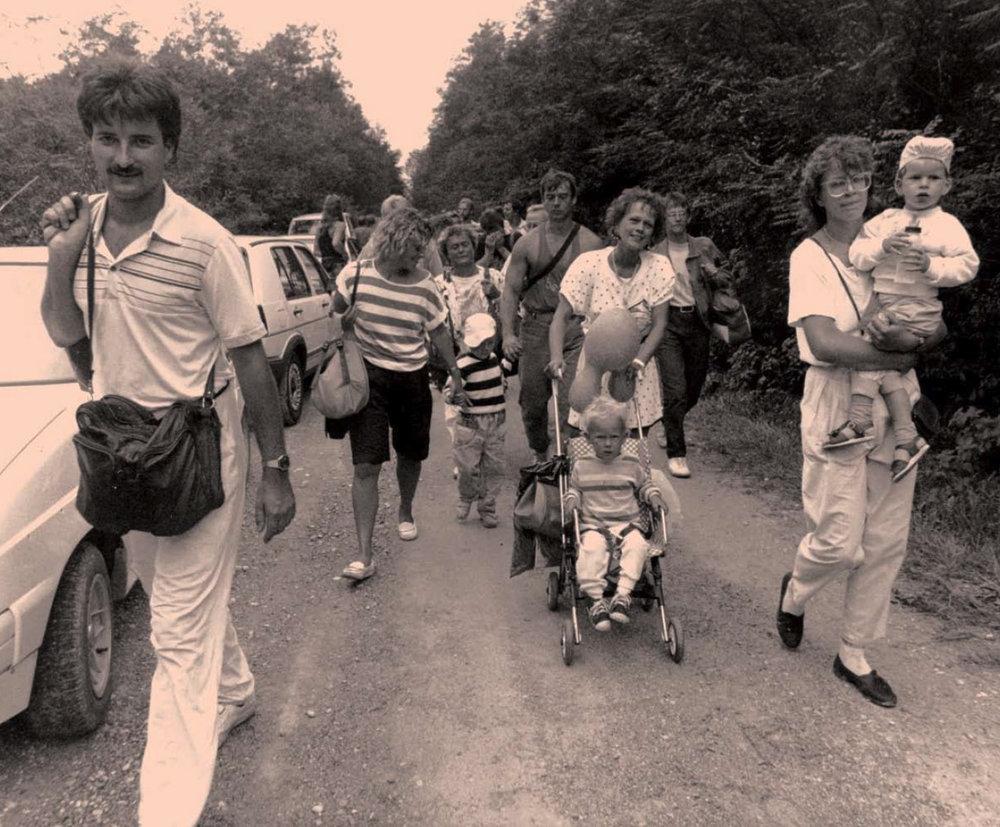 300 East Germans cross the border at St. Margarethen into Austria on September 11. -