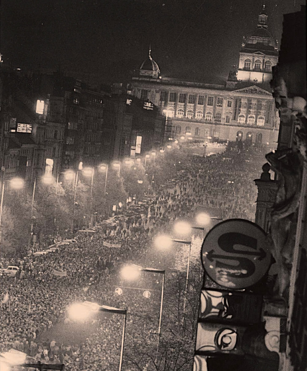 In late November hundreds of thousands of Czechs and Slovaks gather on Wenceslav Square and bring down the Communist government.