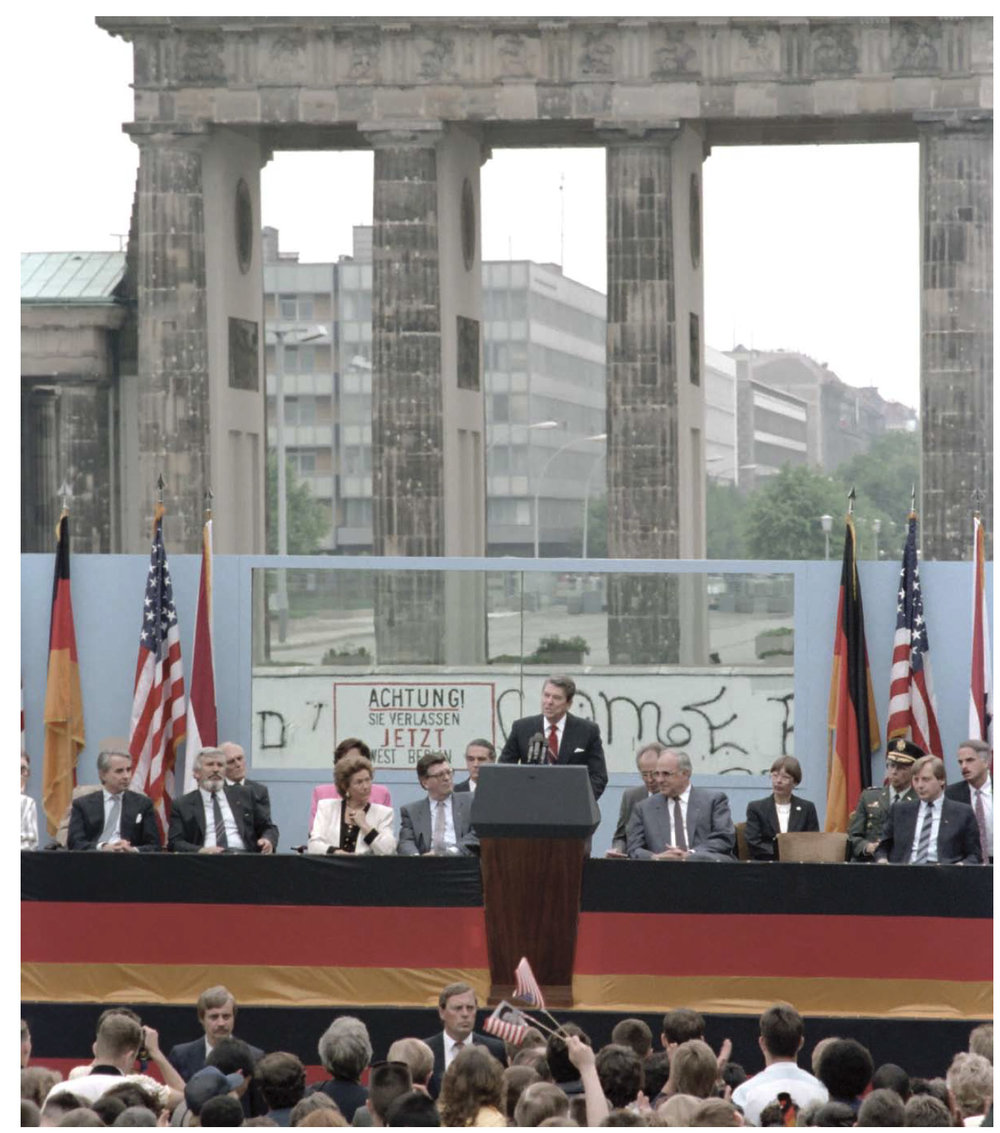 "- President Reagan giving a speech at the Berlin Wall in front of the iconic Brandenburg Gate on June 12, 1987, proclaiming ""Mr. Gorbachev, tear down this wall""!"
