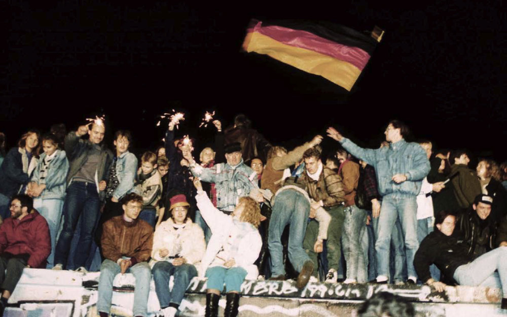The opening of the Berlin Wall unleashes patriotic fervor among Germans which will lead to German unification within a year's time.  -