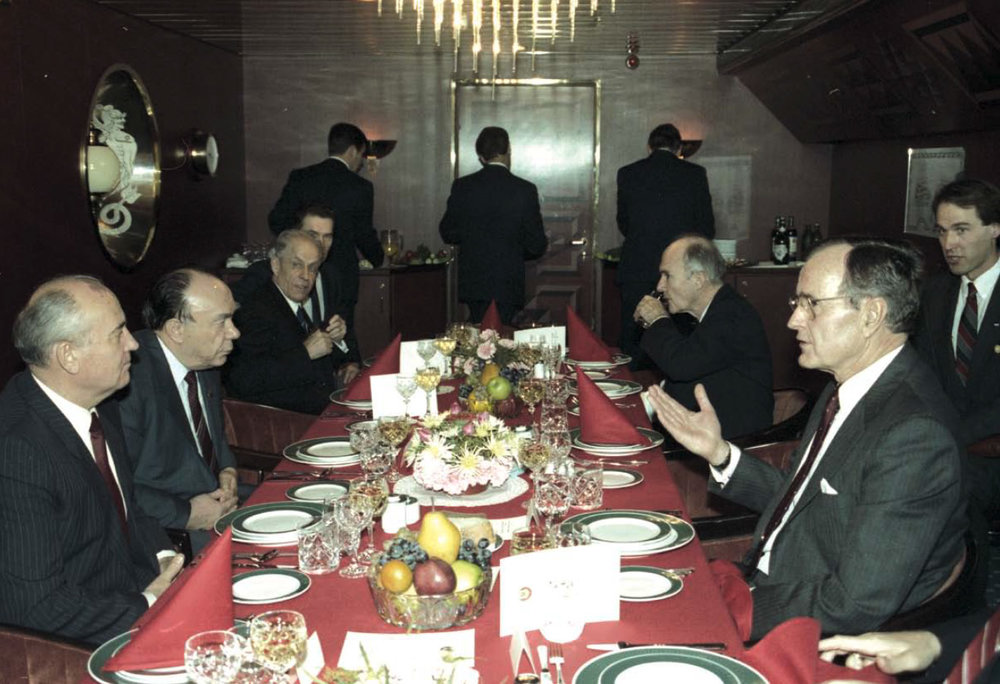 President Bush and Chairman Gorbachev at the Malta Summit (December 2–3, 1989) dinner with their staffs. This summit has been called the most important summit conference since Potsdam in 1945.  It came only weeks after the fall of the iron curtain and the Berlin Wall. It gave both leaders a chance to discuss these dramatic changes and map out future policies.
