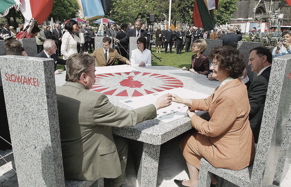 Ambassadors of the ten new EU member states unveil the 'Partner of all nations' table, a memorial with ten granite stone chairs, at the Sigmund Freud park in Vienna, in front of Votivkirche on Friday, 30 April 2004, the day before the official accession to the European Union.