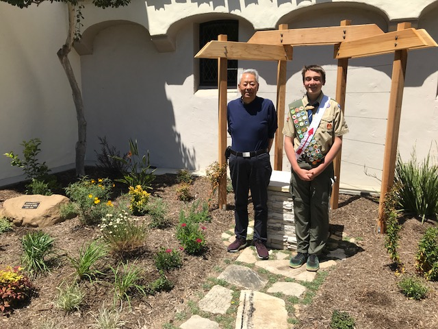 Above: Angel Donor David Yang with Boy scout Christopher Miller, standing in the Shirley Yang Memorial Garden