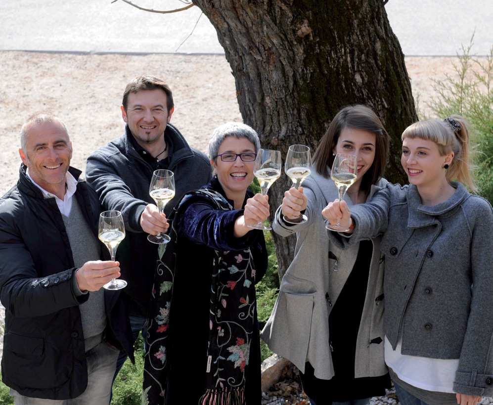 Antonio (left) and Roberta Giuriati Steelier (center) with their team, courtesy Maso Martis.