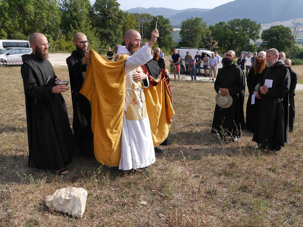 Prior Benedict Nivakoff blessing the land where the new brewery will be built