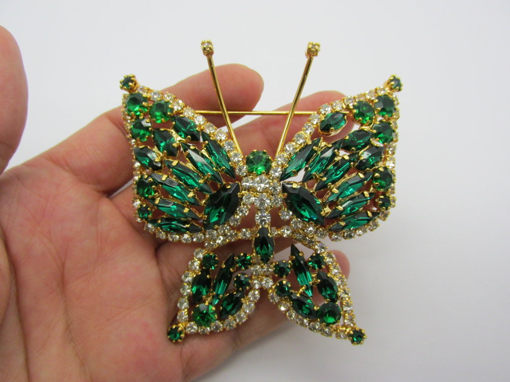 - Beautiful, vintage, DeLizza & Elster, JULIANA, butterfly brooch with glittering wings of green rhinestones.  DeLizza & Elster started making costume jewelry in 1947.  They are most famous for a line of jewelry called