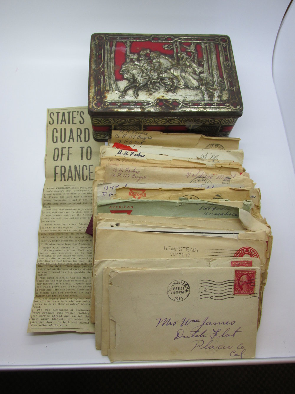- A RARE lot of 50 letters home from a World War I US Soldier which I found in this old tin box.  This is a RARE slice of American history.  The gentleman who wrote the letters was 18 when he started them and then went to World War I and came back.  Such a rare glimpse into a young man's heart, fears, desires, and thoughts during the war.  There is a newspaper clipping from when the California Guard headed to France.  There are 2 letters from 1914, 13 from 1917, approx. 24 from 1918, and 11 from 1919.  The soldier was part of the RAINBOW DIVISION, which was formed in New York in August of 1917 as a way to get 27,000 troops to France quickly for World War I.  It was called the RAINBOW DIVISION because MacArthur said it would stretch across the US like a rainbow.   He was in the 117th Regiment, Company F Engineers.  The young soldier was part of the American Expeditionary Forces.  He started working in the Mill Creek Plant in Redlands as a young man.  He was a blacksmith and would later do horseshoeing in the war.  He traveled to Camp Mills in New York where he wrote