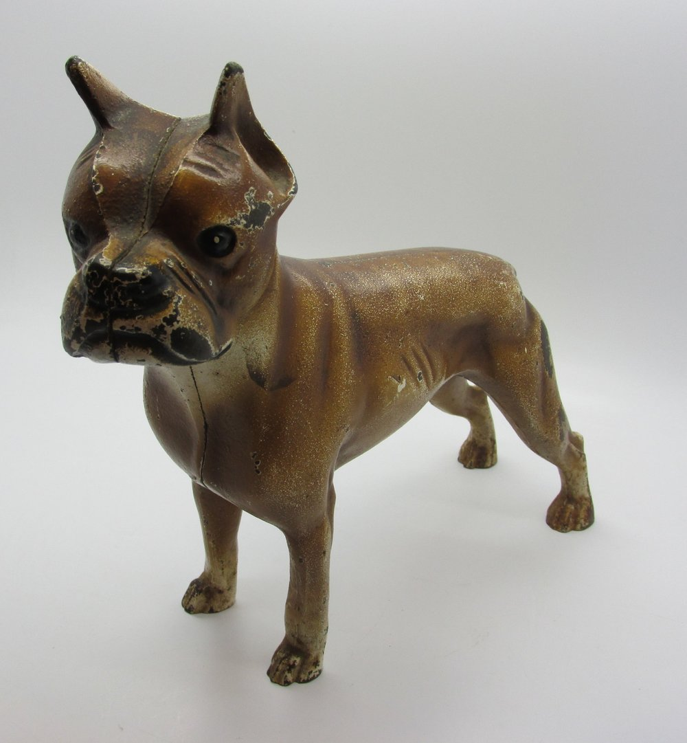 - This little boy is a vintage, Hubley, Cast Iron, Boxer dog.  He is number 307, a large, doorstop size, and very rare.  The Hubley Manufacturing Co., out of Lancaster, PA produced this vintage beauty in the 1930s.  They started making cast iron toys in 1894.  These were made and painted by hand.  He is quieter than most dogs and doesn't eat as much.  This vintage Hubley doorstop is available on my ebay site. Click here to view.