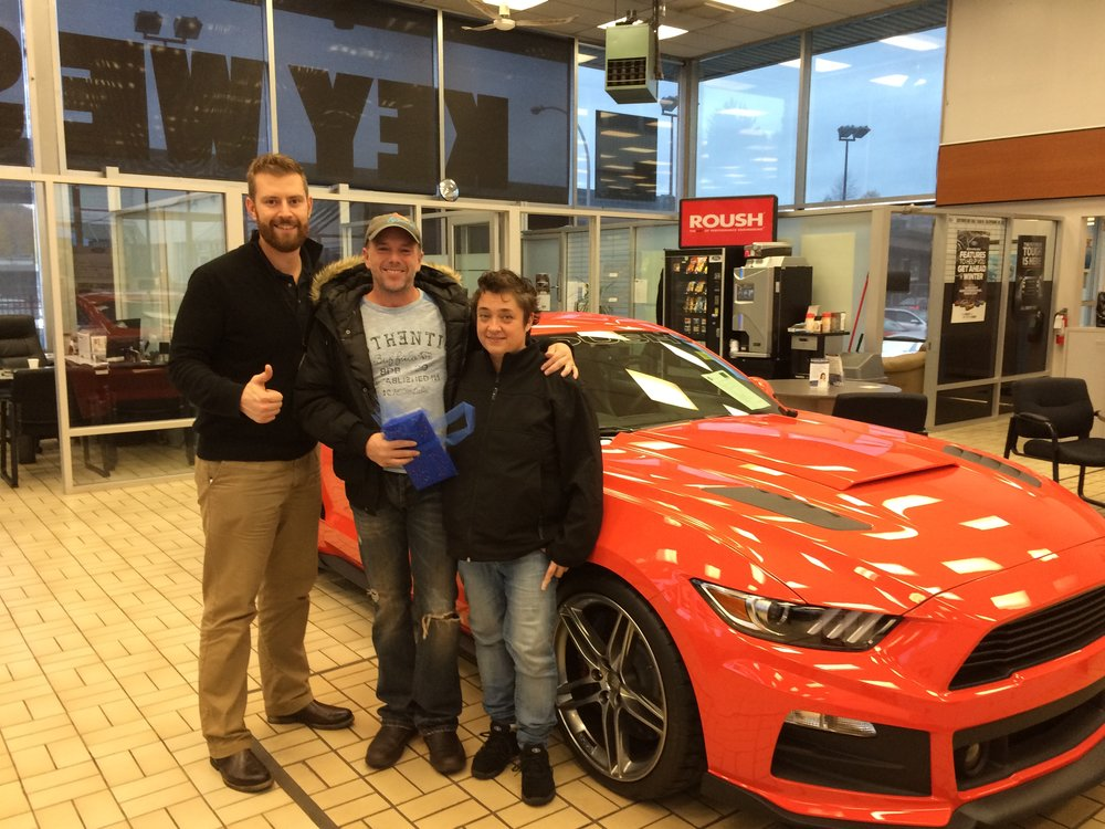 ryan with roush and custies in showroom.jpeg