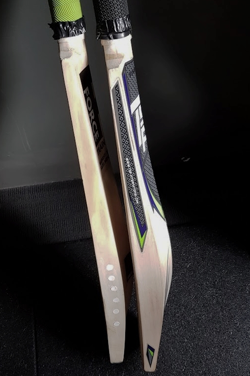 The ForceTrainBetter T3 on the left, standard 2 lb 10 bat on the right.