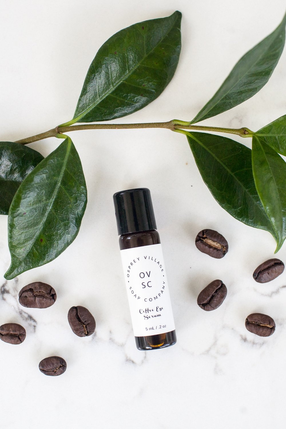 Coffee Eye Serum - by Osprey Village Soap Company Say goodbye to dark circles and puffy eyes! This Coffee Eye Serum is an infused oil that lightens under-eye circles while removing puffiness. Coffee works wonders for our skin.  The caffeine helps tighten fine lines (like the ones around our delicate eye area), and reduces puffiness by preventing blood flow to the area. The stimulating properties of coffee also brightens your skin.. Combined with super-oil rosehip, vitamin E oil and scented with luxurious neroli essential oil which helps regenerate skill cells and improves the skin's elasticity.Gently roll under your eyes before bed and in the morning after washing your face. Our glass vial includes a metal roller ball for a cooling application that further reduces puffiness.  Osprey Village Soap Company never uses fillers or unnecessary additives so a little goes a long ways!Click HERE to shop online!Click HERE to find stockists!