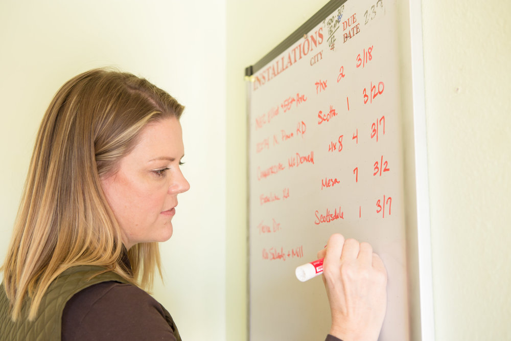 Meghan copying the orders from one whiteboard to another. Again.