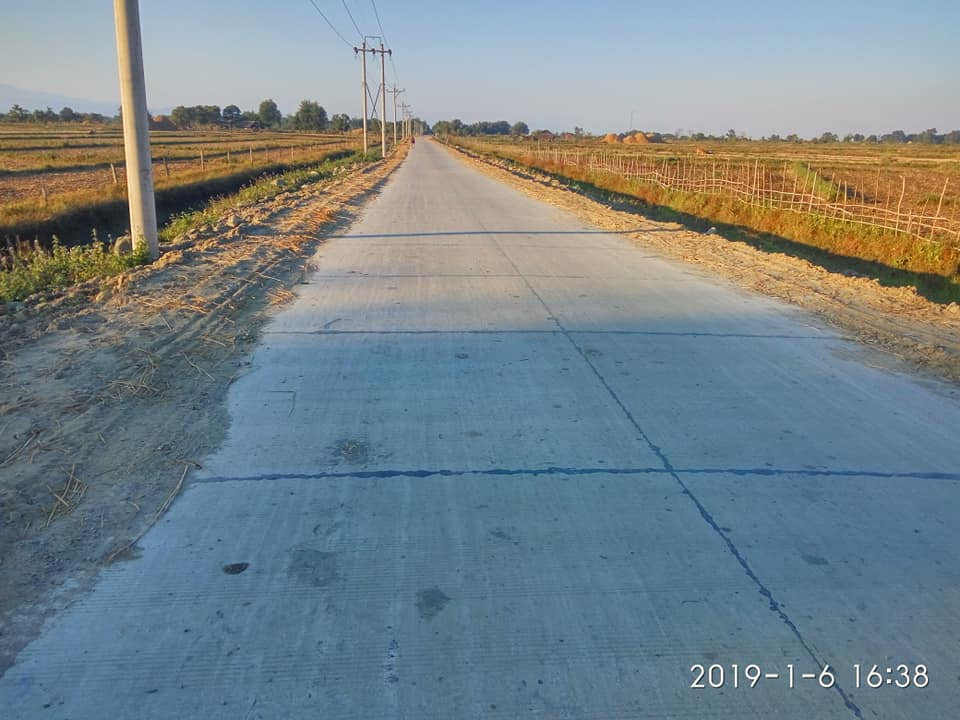 The newly paved road along the eastern edge of Indawgyi has made once hard-to-reach villages much more easily accessible. (Photo: Kyaw Kyaw Win, Kachin State Hluttaw)