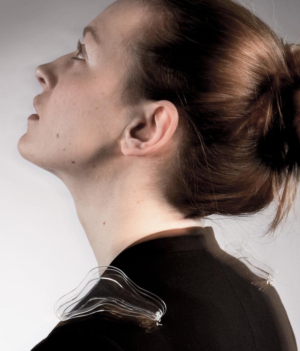 ghost shoulder pieces worn by model.jpg