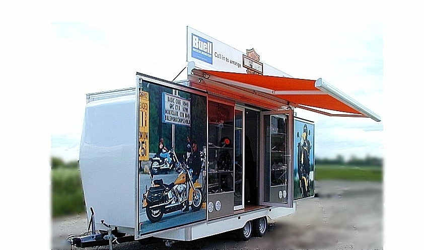 Branded promotional exhibition trailer with canopy and fold out doors, easy access ramp and headboard, logo, manufactured in Sussex by Blackburn Trailers