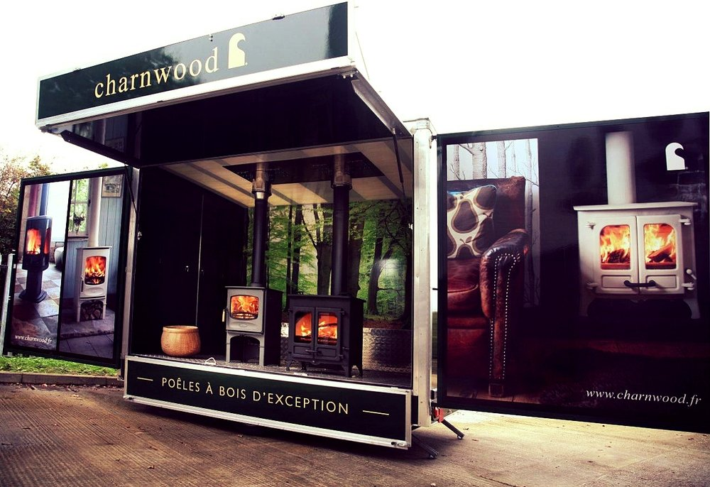 Charnwood micro sleek promotional exhibition trailerx in Susse with stove display, fold out doors, easy access and well designed.