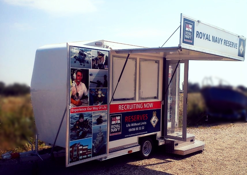Promotional Exhibition trailer built by Blackburn Trailers in Sussex, with a roof canopy and fold out doors, single axle easy access striking graphic design