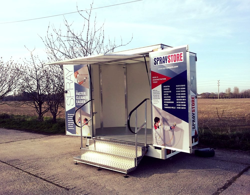spray store micro exhibition trailer built in Sussex, fold out doors and steps with hand rails for easy access, functional design