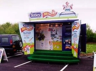 Tetley promotional exhibition trailer with fold out doors and roof canopy, fold out steps and functional design built in Sussex by Blackburn Trailers