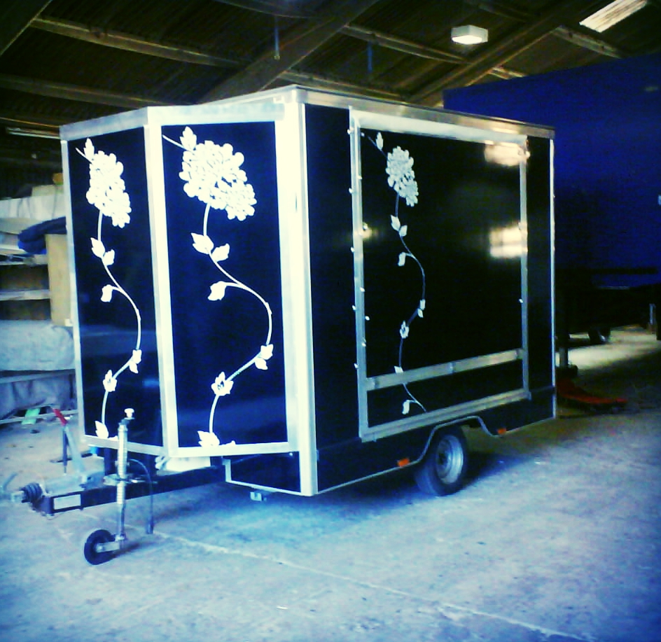 Closed micro exhibition trailer with striking graphics and single axle easy to maneuver and tow, built in Sussex