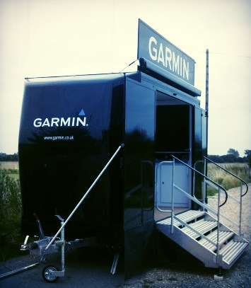 Garmin exhibition trailer built in Sussex, with side panels, awning and fold out steps, functional design and striking logo graphics
