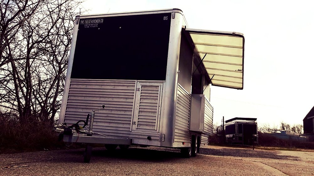 Exhibition trailer built in sussex, silver sleek catering trailer with roof canopy and economic design