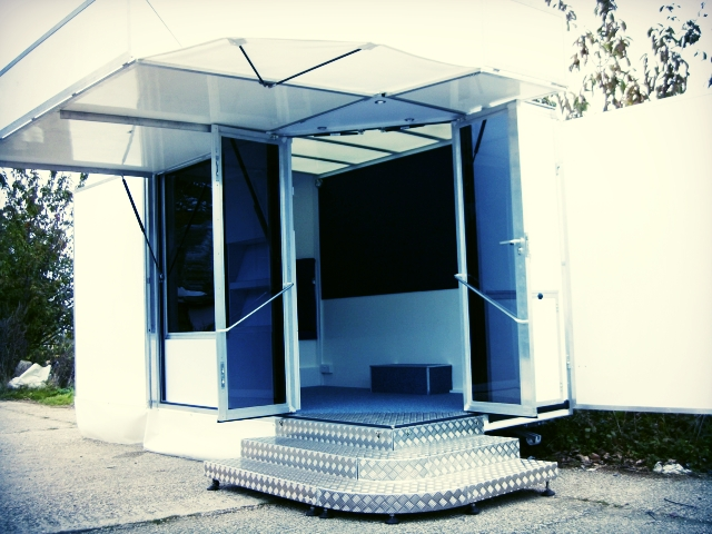 Micro exhibition trailer from the Kompak range in Sussex. Fold out doors, economically designed promotional unit
