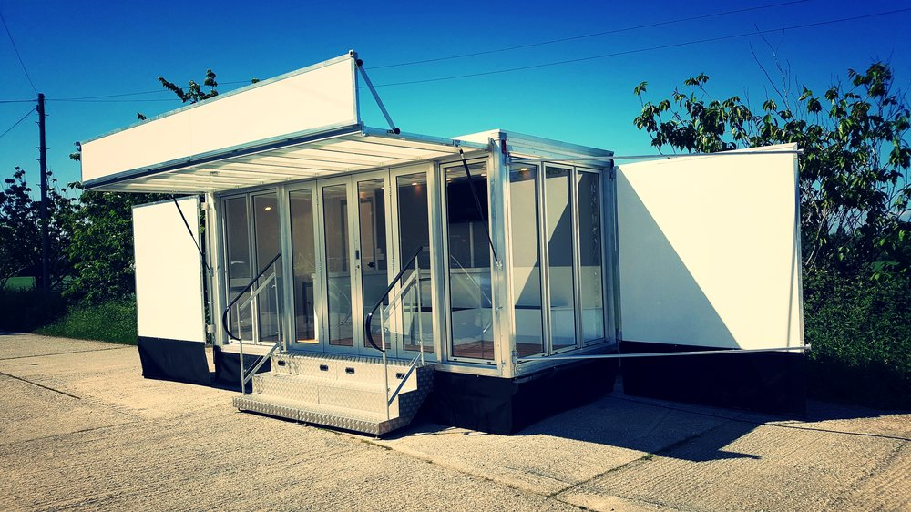 Maxi exhibition trailer with fully glazed front panel, fold out doors and steps with hand rails, fully functional bespoke trailer built in Sussex