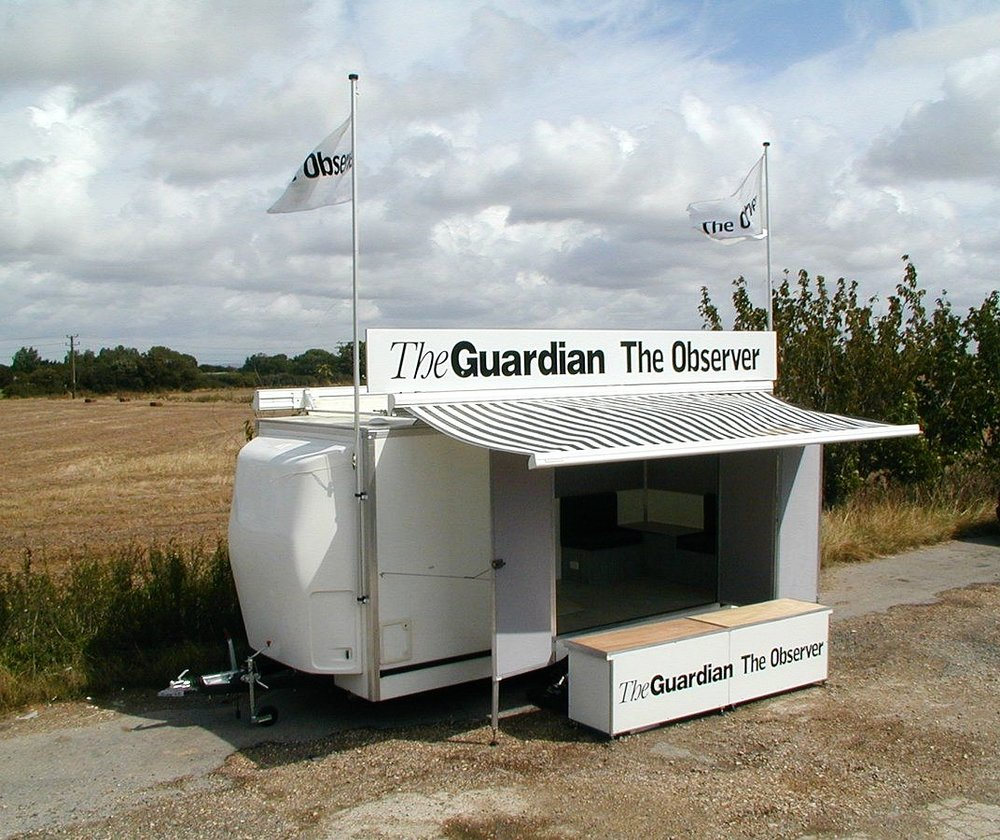 Branded promotional exhibition trailer for events and expo with canopy and fold out doors, easy access ramp and headboard, logo, manufactured in Sussex by Blackburn Trailers. Built for the Guardian newspaper, branded exhibition trailer