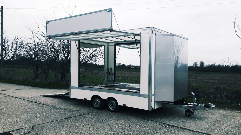 Promotional Exhibition Trailer manufactured in England, commercially designed beautiful well built Trailer with striking graphics, twin axle mobile showroom for expo's and event display, exhibition unit.