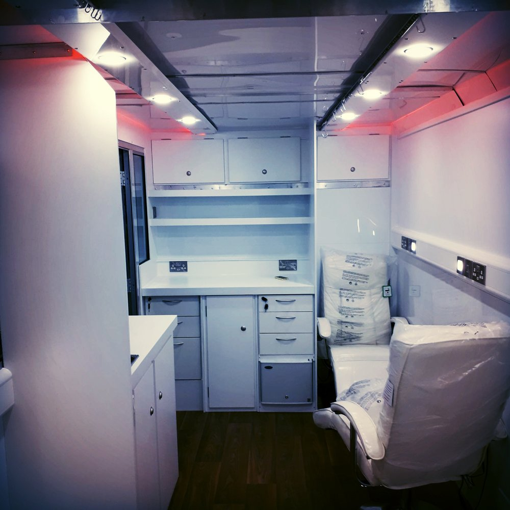 interior bespoke trailer for Get a Drip, including medical equipment and seating with a plush design