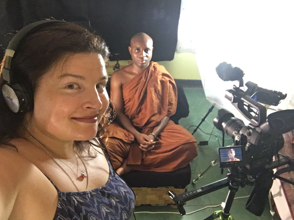 Jenn and Venerable S filming Minding Shadows interviews at Banana Village in Uganda.