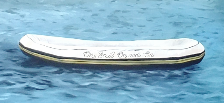 "Detail shot of the raft reading ""On, Sail On and On"""