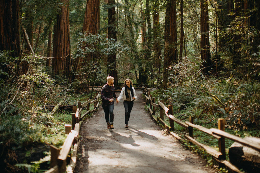 couple running under the redwoods