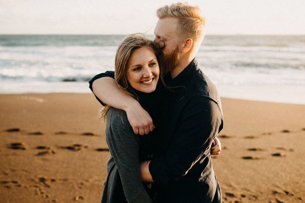 cool couple hugging on the beach