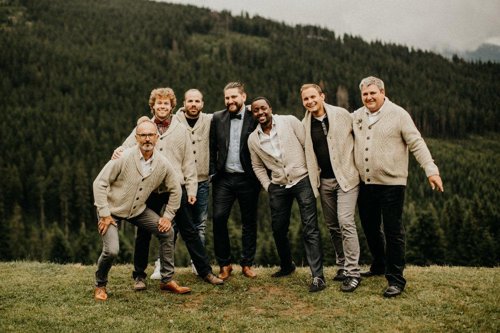 hipster groomsmen wearing matching cardigans