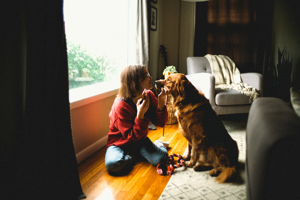 portrait of a girl playing with her dog in Portland Oregon