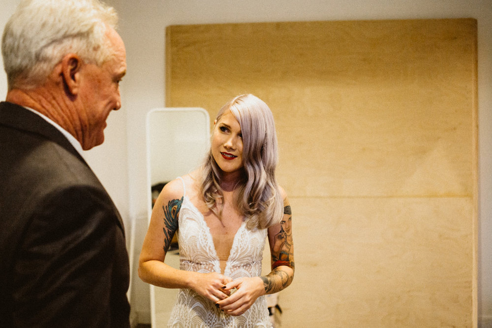 bride greets her dad before the ceremony