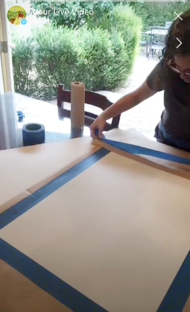 Taping  masking paper to the front. -