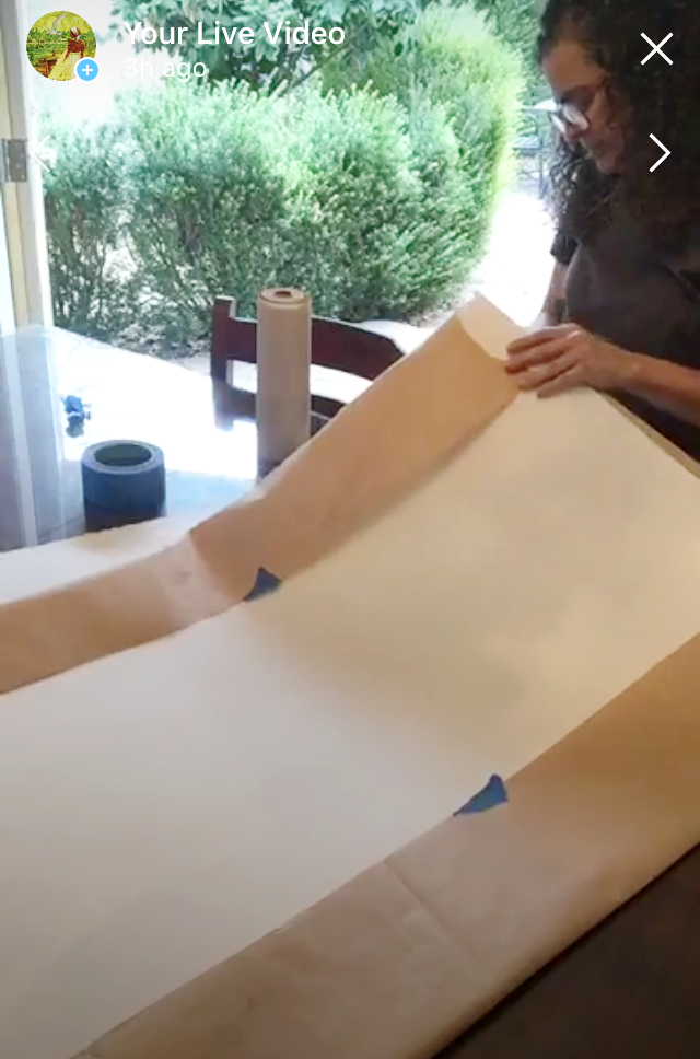 Folding the masking paper over to the back side and taping in place. -