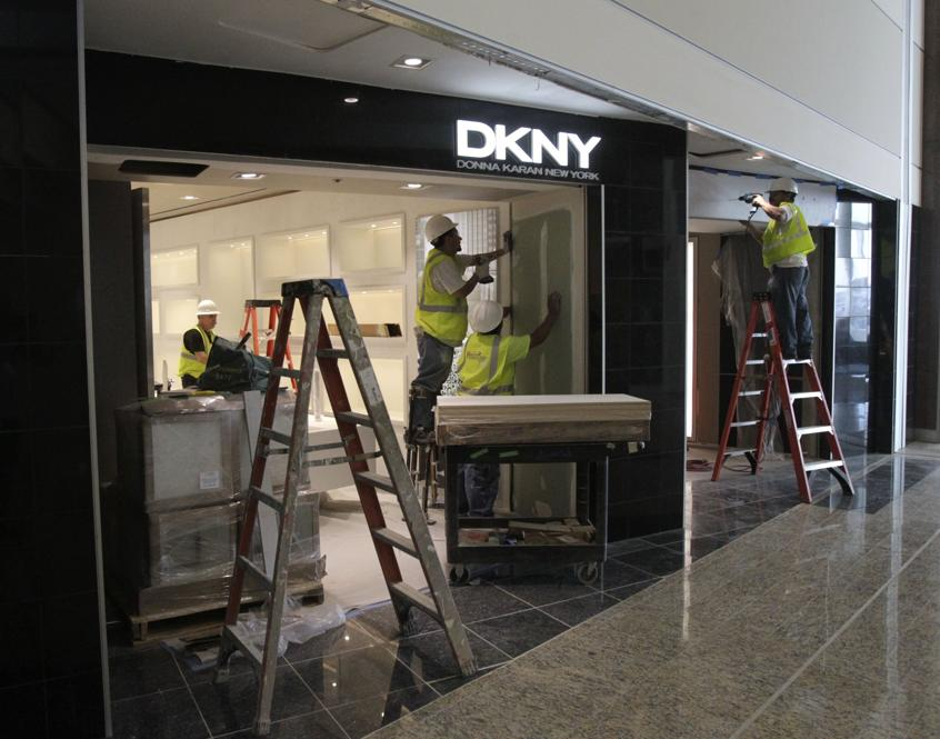 In this 2012 photos, workers prepare the DKNY store at Hartsfield-Jackson International Airport.(Bob Andres / AJC file photo)