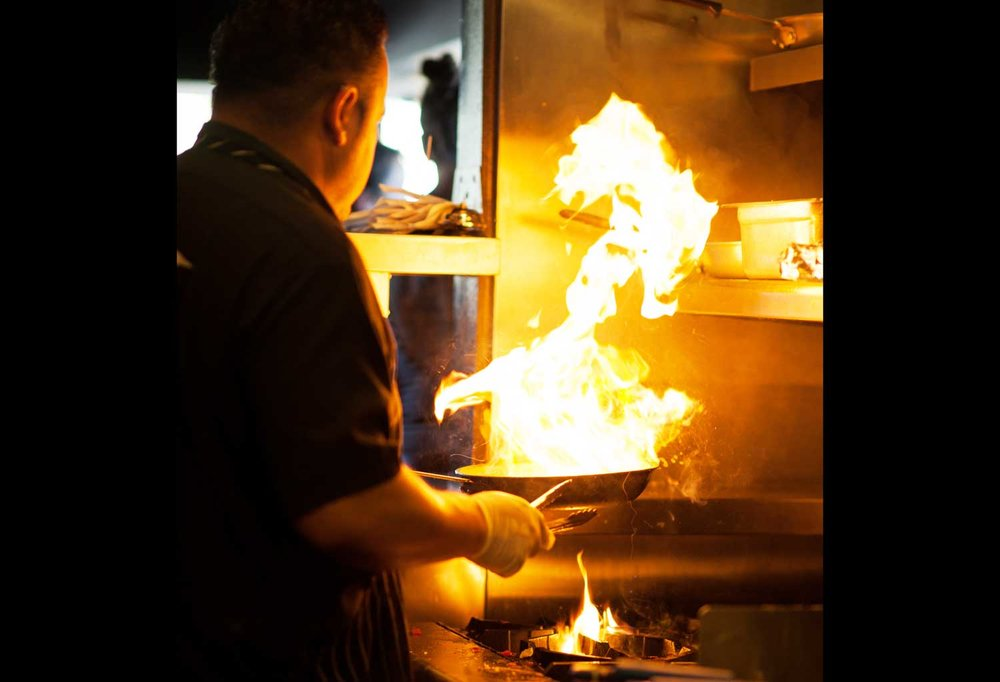 hudson-restaurant_cook-with-flames.jpg