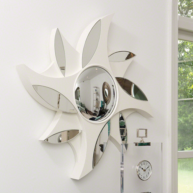 Pinwheel Mirror - This remarkable mirror was Inspired from our childhood love of pinwheels. Constructed of ivory lacquered and mirrored sections , it will liven up any wall. 36.5″Dia. x 3.25″Deep