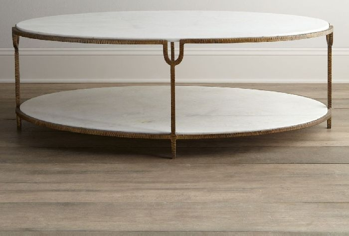 Iron and Stone oval Coffee Table - Cool, creamy white Udaipur marble and modern, industrial iron come together in a display of strength and beauty, unique hammered texture. A luxe gold painted finish elevates the look and transforms it into something impeccably dynamic! 52