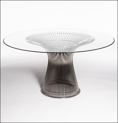 "Strand Dining Table - Sculptural flared rod dining table base in nickel plated steel with a beveled edge tempered glass top. Diameter of top of base 34 ½"" Diameter of bottom of base 20""Height 27"""