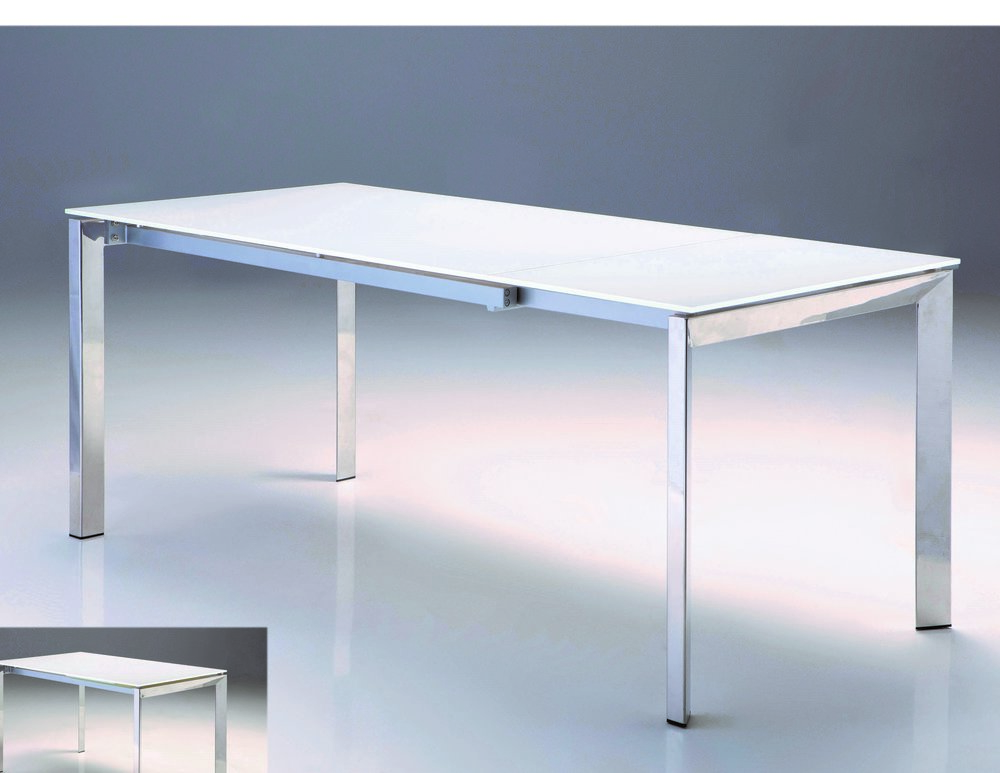 Ghost Dining Table - The GHOST extending table is aptly named for not taking up any visual space in your otherwise small space. It is constructed with a reflecting polished steel base and a white tempered glass top. It features a leaf that extends out from one end when you slide the set of legs out to accommodate 51 x 34 x 30