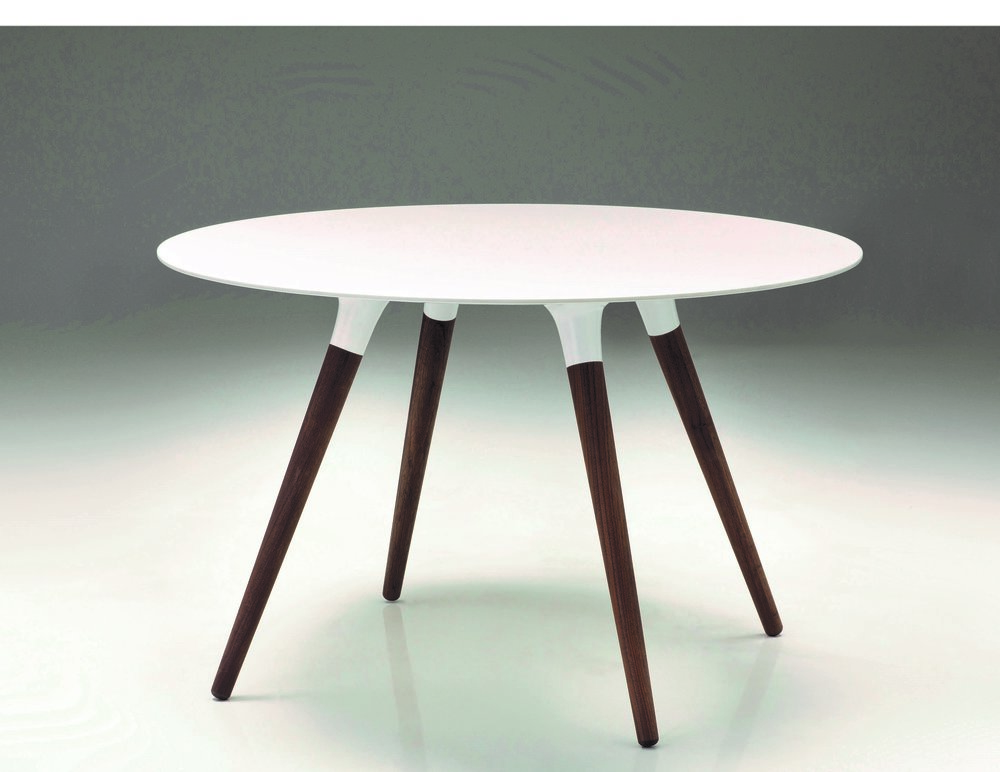 Iztuzu Dining Table - The stylish Iztuzu table is constructed with a beautifull mottled solid surface top similar to that which is used on kitchen counter tops which makes it super durable and practical. It is bacteria and mould resistant and easy to clean and the legs are made from a rich solid wanut which is clearcoated. 48